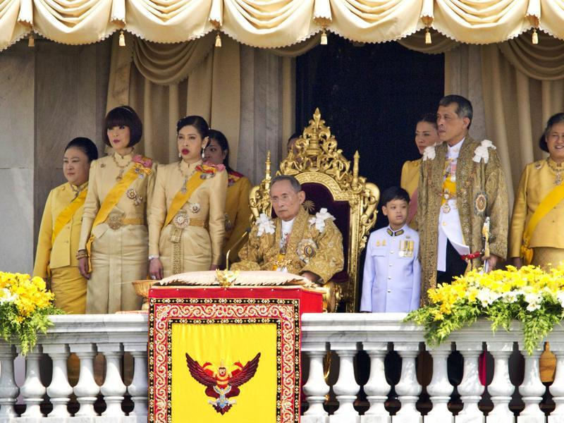 In this Dec. 5, 2012, file photo, Thailand's King Bhumibol Adulyadej, seated centre, and his family members, from left: Princess Somsavali, Princess Ubolratana, Princess Chulabhorn, Princess Siribhachudabhorn, Royal Consort Princess Srirasm, Prince Dipangkorn Rasmijoti, Crown Prince Vajiralongkorn, Princess Sirindhorn; after addressing the crowd from a balcony of the Ananta Samakhom Throne Hall on his 85th birthday in Bangkok.  (AP)