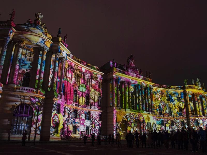The first event was held in 2004 and celebrated its 10th anniversary in 2014. Colourful designs are projected on the Faculty of Law building of the Humboldt University. (AFP)