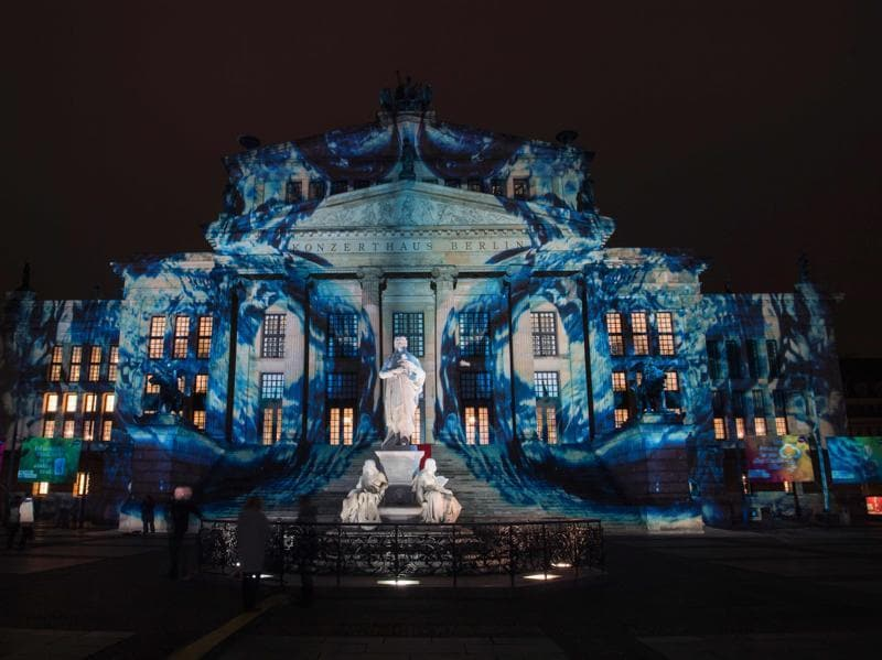 Special tours by bus, bicycle, taxi and boat are convenient ways to experience as many of the illuminated buildings as possible. Colourful designs are projected on the facade of the Berlin Concert Hall (Konzerthaus). (AFP)