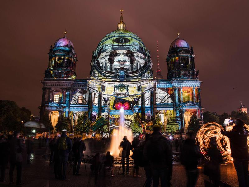 Colourful designs are projected on the facade of the Berlin Cathedral (Berliner Dom). (AFP)