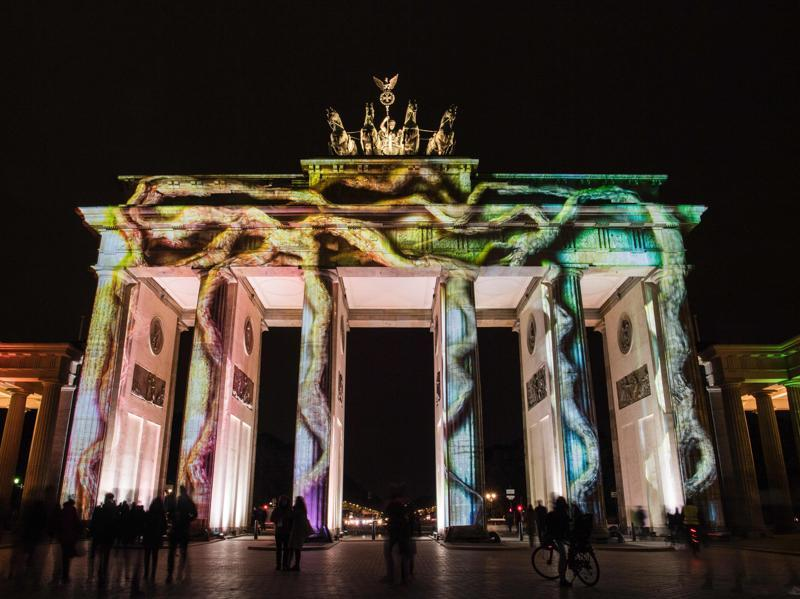 Yet another colourful design projection on the facade of the Brandenburg Gate. (AFP)