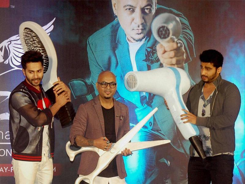 Arjun Kapoor, Varun Dhawan and celebrity stylist Aalim Hakim during the launch event. (PTI Photo)