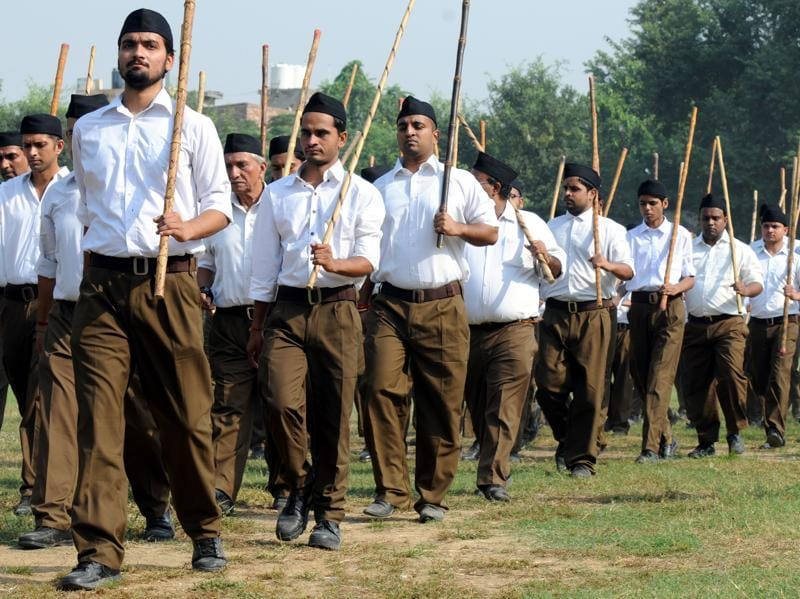 RSS volunteers take part in a parade march in full brown pants after the Shastra Pujan (Weapon worship) in DSD Government College in Gurgaon on October 11, 2016. (PARVEEN KUMAR / HT PHOTO)