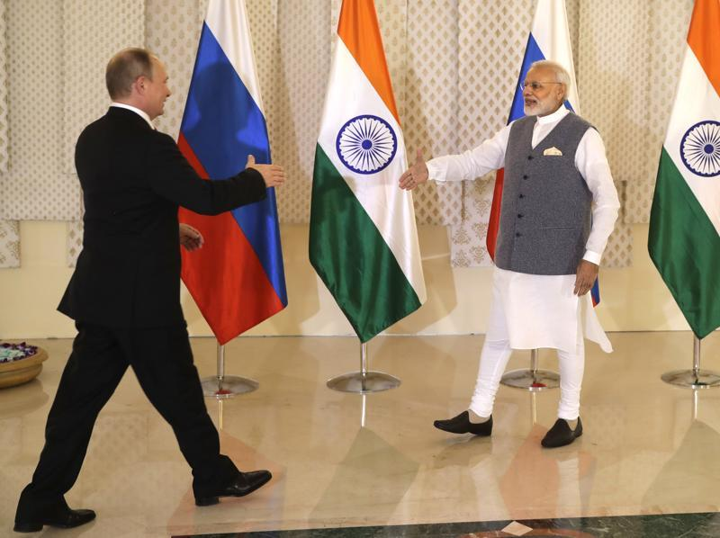 Prime Minister Narendra Modi shakes hand with Russian President Vladimir Putin during their annual bilateral meeting, on the sidelines of the BRICS Summit on Saturday, Oct 15. (AP)