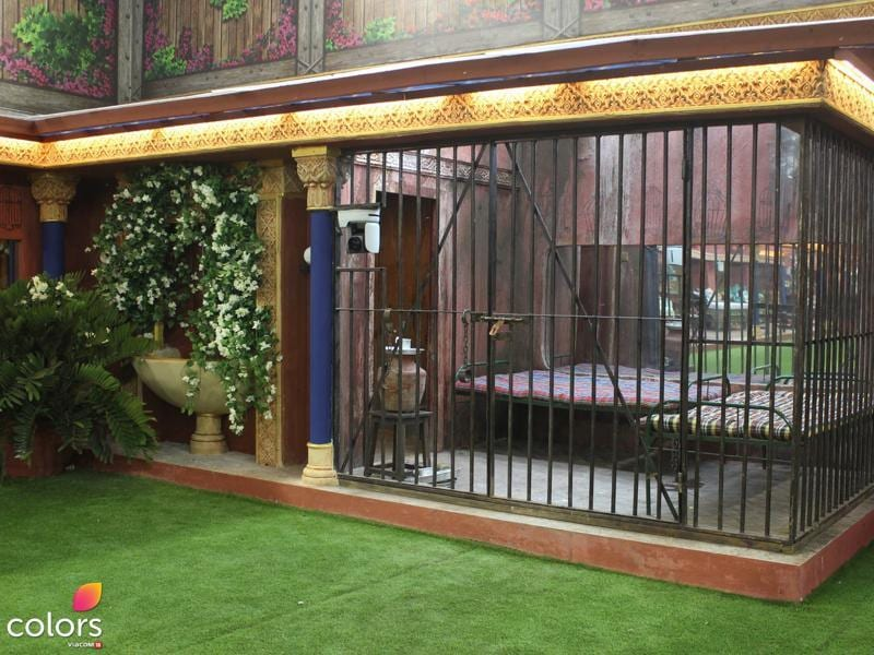 Contestants have always been prone to making errors and breaking the rules of the Bigg Boss house. This year, the house brings back one of its darkest elements, the jail. Painted to appear filthy to its inmates, the jail is splattered with gruesome material; this dungeon promises to be as good as hell. Located in a corner in the garden area, the jail has two iron khatiyas with dusty bedding. Aluminium utensils, an earthen water pot and an Indian-style washroom, the Bigg Boss jail will give suitable punishment to those who err. (COLORS)