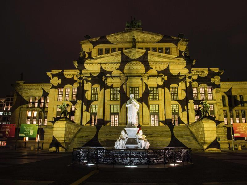 Colourful designs are projected on the facade of the Berlin Concert Hall (Konzerthaus) on the Gendarmenmarkt . (AFP Photo)