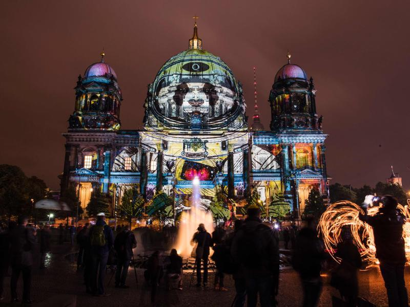 Colourful designs are projected on the facade of the Berlin Cathedral (Berliner Dom). (AFP Photo)