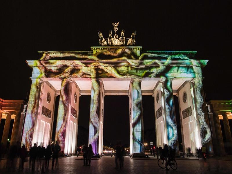 Colourful designs are projected on the facade of the Brandenburg Gate during the Festival of Lights in Berlin. (AFP Photo)