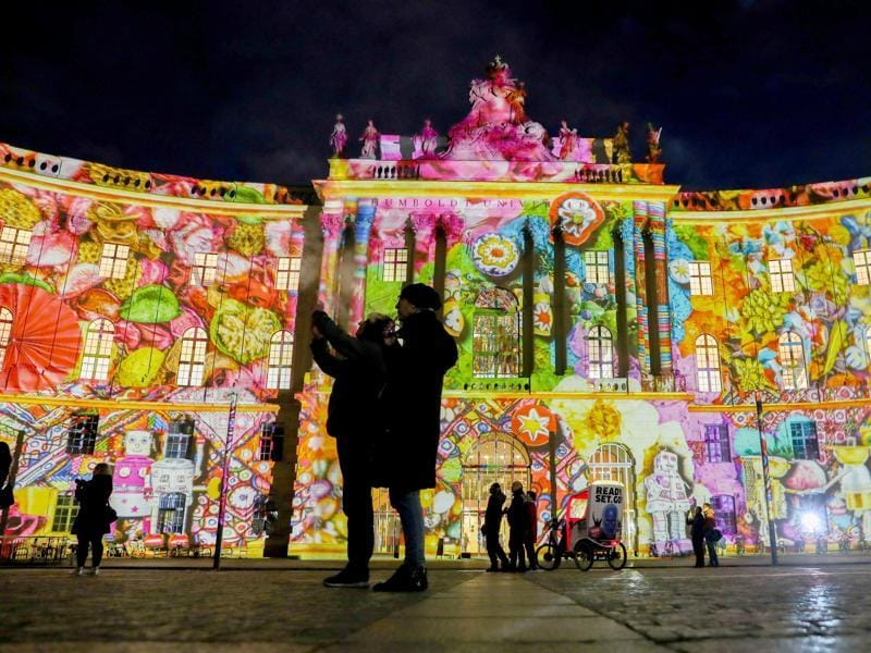 The juridical library of the Humboldt University is illuminated by colorful lighting in Berlin, Germany as part of the Festival of Lights. (AP Photo)