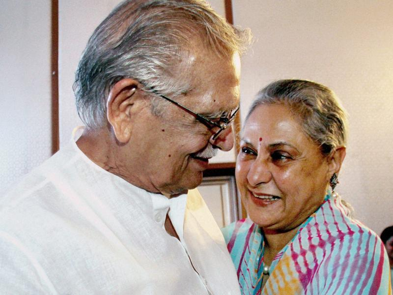 Jaya Bachchan and Gulzar share a light moment during the launch of the album Gulzar in conversation with Tagore. (PTI Photo)