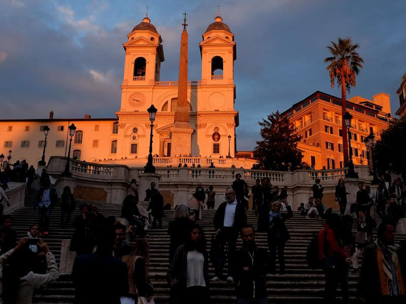 People walk the Spanish Steps, with the Trinita dei Monti church in background, on October 18, 2016 in Rome during the Rome Film Festival. (AFP)