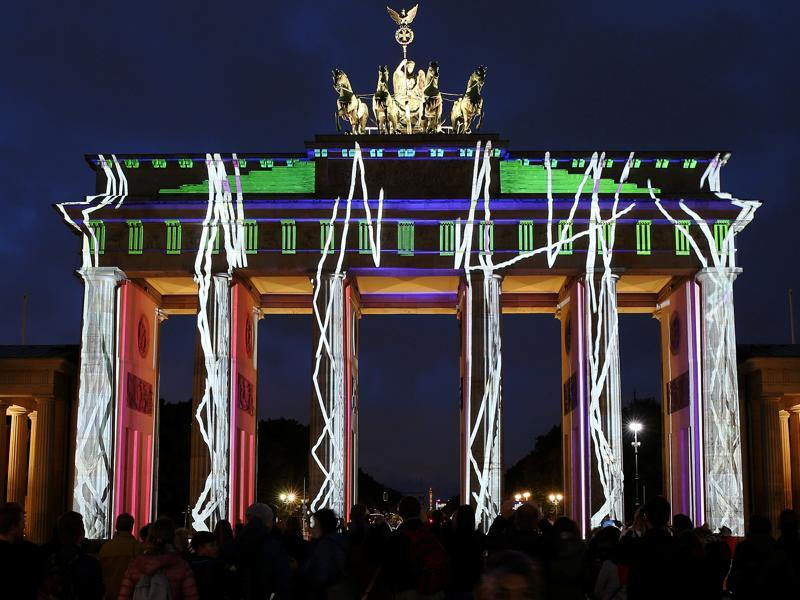 The Brandenburg Gate is illuminated during the Festival of Lights show in Berlin, Germany. (REUTERS)