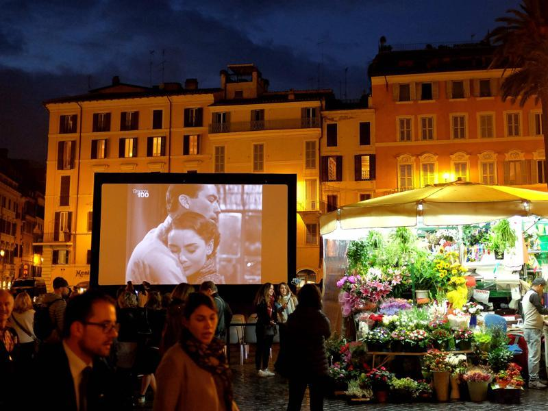 Images of actors Audrey Hepburn and Gregory Peck are displayed on a screen during the outdoor screening of the 1953 movie Roman Holiday on October 18, 2016 in Rome's Spanish Square as part of the 11th Rome Film Festival. Through October 13-23, 2016 the city of Rome hosts a series of events to celebrate the centenary of the birth of Gregory Peck, as William Wyler's Roman Holiday was the first American film to be shot entirely in Italy.  (AFP)
