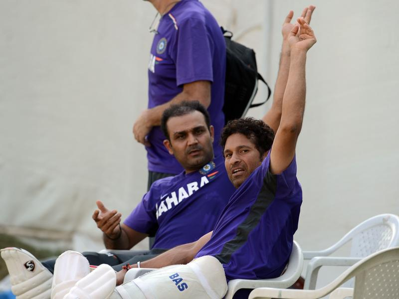 Sachin Tendulkar (R) and Sehwag gesture during a training session during the India-England home series in November 2012. (AFP)