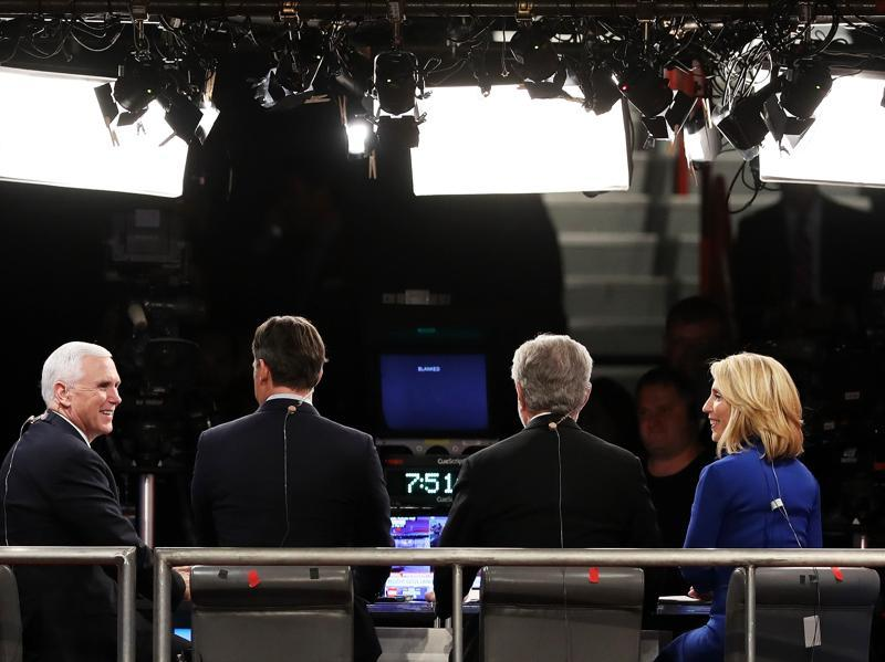 Republican vice-presidential nominee Mike Pence speaks with the CNN broadcast crew prior to the start of the third US presidential debate. (AFP Photo)
