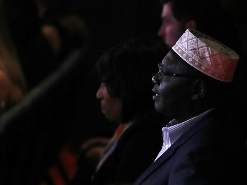 Malik Obama, President Barack Obama's Kenyan-born half-brother, listens to the candidates speak during the third US presidential debate. (AFP Photo)