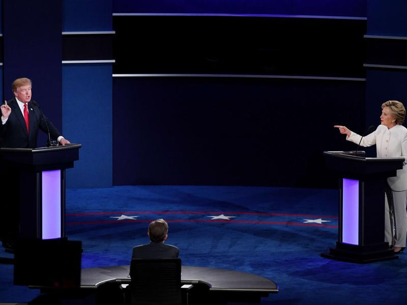Democratic presidential nominee and former secretary of state, Hillary Clinton, debates with Republican presidential nominee Donald Trump during the third US presidential debate. (AFP Photo)