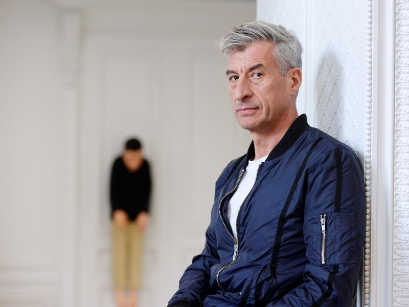 Cattelan poses with one of his creations.  (AFP)
