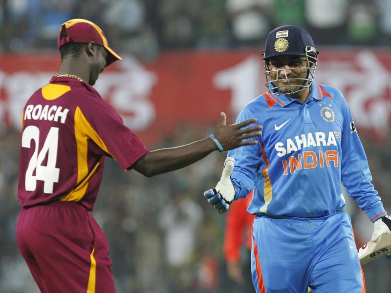 Sehwag is congratulated by West Indies' Kemar Roach for his double century. (Santosh Harhare/HT Photo)