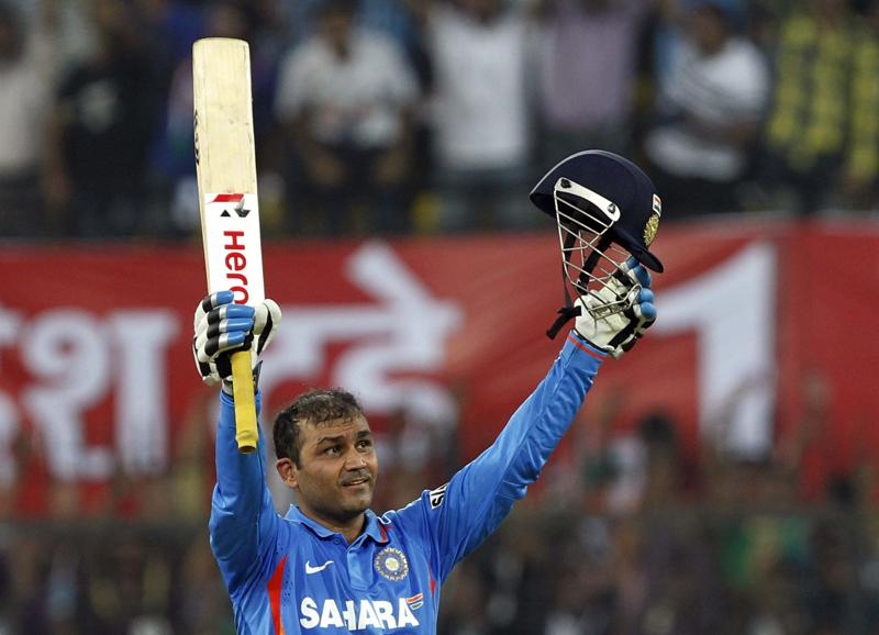 Virender Sehwag celebrates scoring a double hundred during the 4th ODI between India and West Indies at Holkar Stadium in Indore on December 8, 2011. (Santosh Harhare/HT Photo)