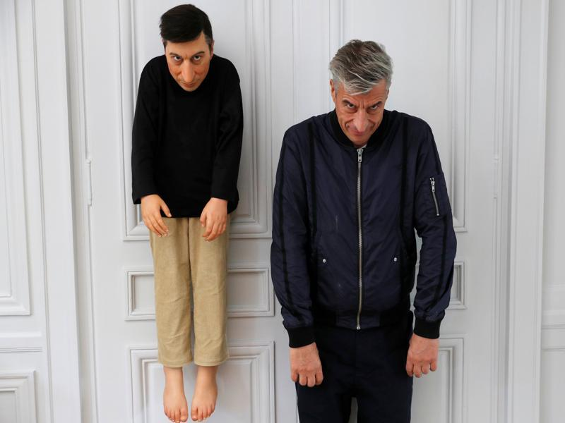 Cattelan poses with his creation La Rivoluzione Siamo Noi (2000) on October 17, 2016. (REUTERS)
