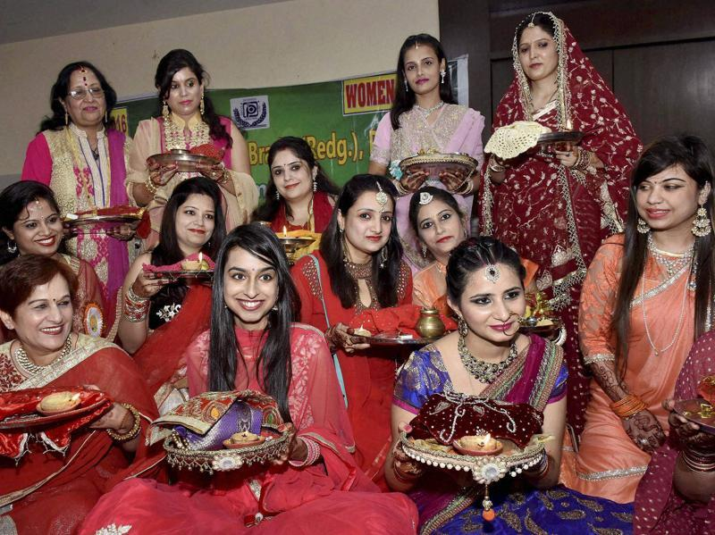 Married women perform rituals on the occasion of Karva Chauth in Patna on Wednesday.  (PTI)