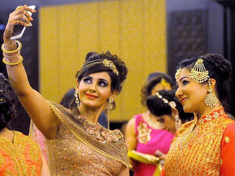 Not all of us know who invented Hindu festival Karva Chauth. But married women owe him/her a lot. When/how else would they dress up like a bride every year? (PTI)