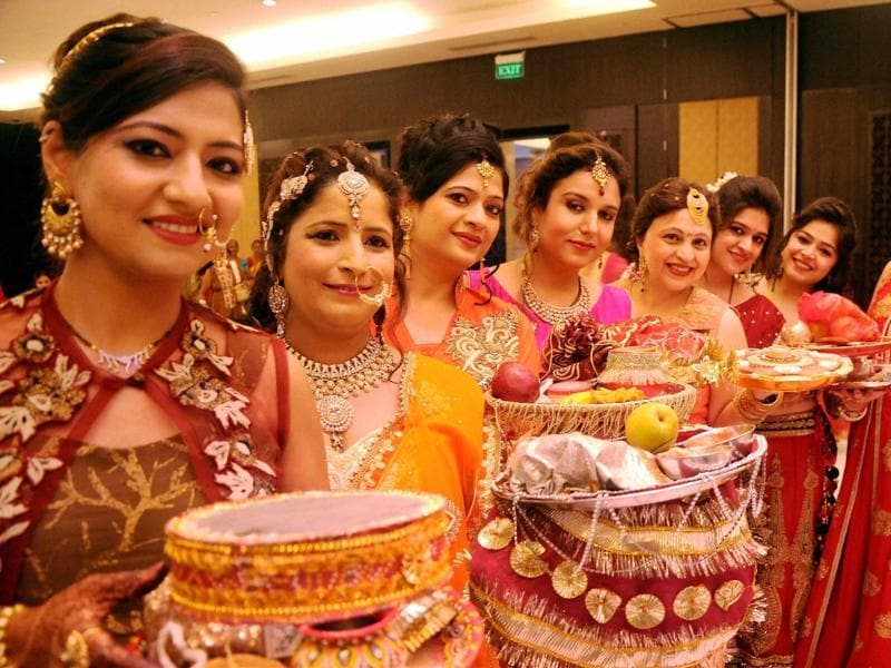 Women pose for on the occasion of Karva Chauth in Indore. (PTI)