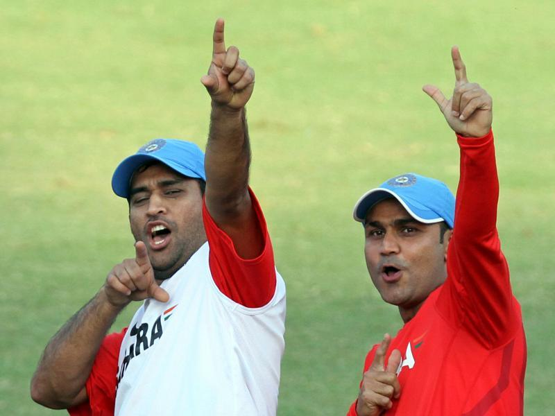 Sehwag and Dhoni share a lighter moment at a practice session during the 2011 World Cup in India. (Mohd. Zakir/HT Photo)