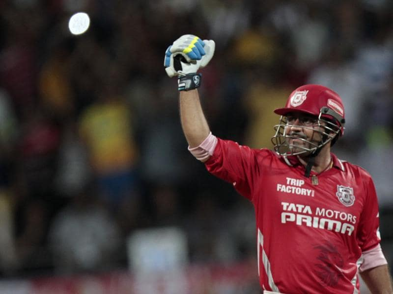 Sehwag celebrates his century for Kings XI Punjab during the IPL match against Chennai Super Kings at Wankhede Stadium in Mumbai on May 30, 2014. (Kunal Patil/HT Photo)
