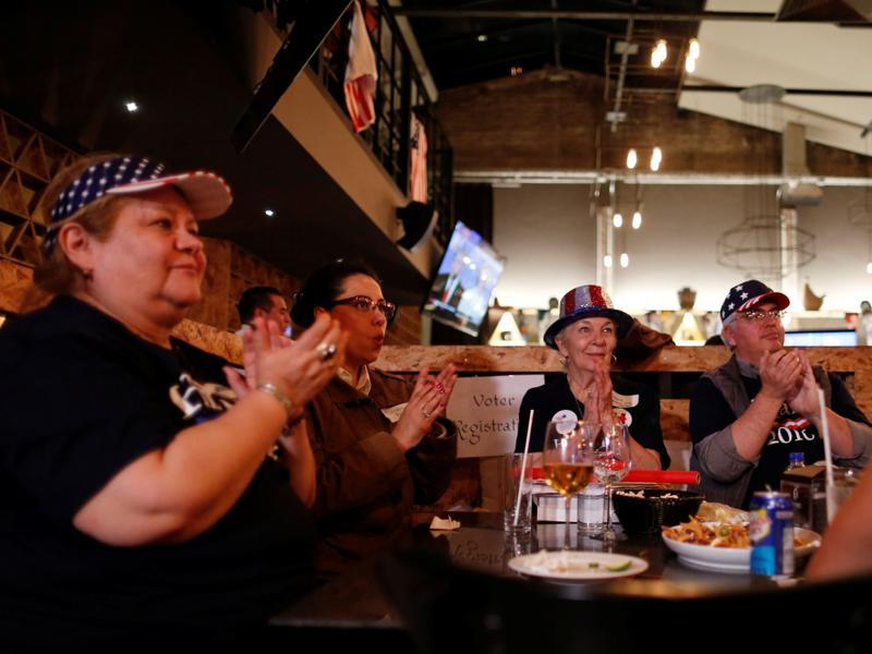 Democrats react as they watch a television broadcast of the third presidential debate at a restaurant in Mexico City, Mexico. (Reuters Photo)