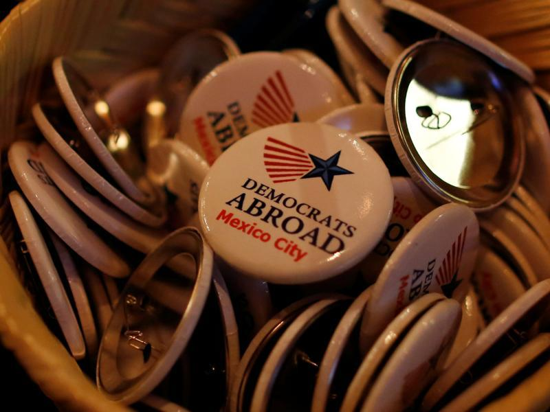 Pins are seen at a Democrats Abroad television broadcast of the third presidential debate. (Reuters Photo)