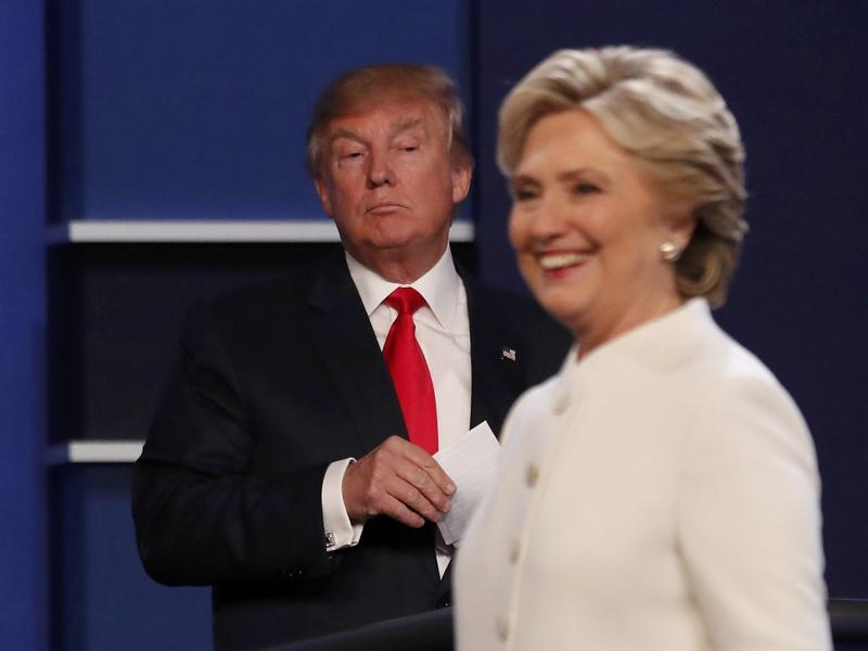 Republican US presidential nominee Donald Trump and Democratic nominee Hillary Clinton finish their third and final 2016 presidential campaign debate at UNLV in Las Vegas. (Reuters Photo)