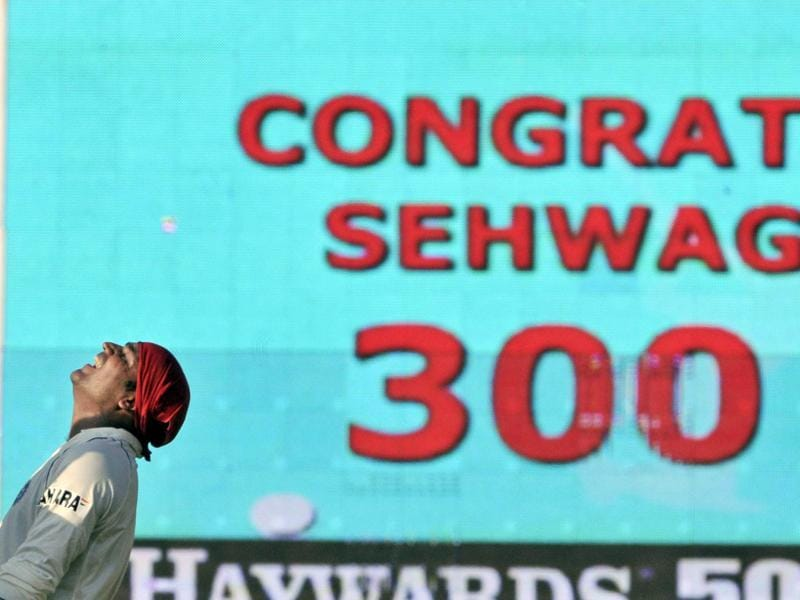 Sehwag looks up to the heavens in celebration as a TV screen flashes congratulations for scoring a triple ton, his second, on the third day of the first Test against South Africa in Chennai on March 28, 2008. (AP)