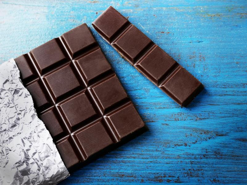 Dark chocolate: Instead of reaching for store-bought chocolate bars or biscuits when hunger strikes, try taking a little time to prepare your own home-made snacks. Try filling a small box with two squares of dark chocolate per day or crystallised ginger. (Shutterstock)