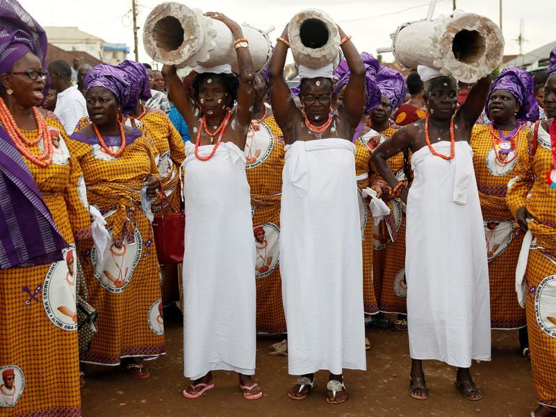 Women carry traditional drums during coronation of Oba of Benin. The founders of the empire were the Edo people. Oba of Benin is the traditional ruler of the Edo people. (REUTERS)