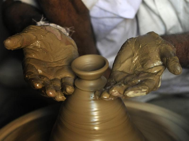 Wet clay is moulded in the expert hands of the potters, many of whom have learnt the craft from their forefathers. (Sunil Ghosh  / HT PHOTO)