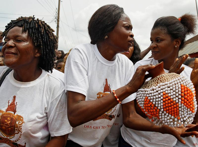 Women sing during the coronation ceremony. The first Europeans to reach Benin Empire were the Portuguese explorers in about 1485. (REUTERS)