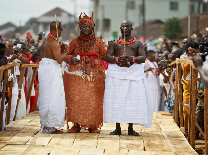 Newly crowned Oba of Benin Kingdom Eheneden Erediauwa is guided through a symbolic bridge by the palace chiefs during his coronation in Benin City, Nigeria October 20, 2016. Not to be confused with the modern country of Benin, this empire was a pre colonial one located in southern Nigeria. (REUTERS)