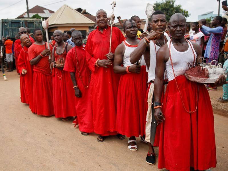 Traditional cult members carry sacrifices at a procession during the coronation ceremony. Trade was established between the two nations with the Edo trading tropical products such as ivory, pepper and palm oil in exchange for European goods such as manila (buff-coloured fibre of the banana family used to make paper and rope) and guns.  (REUTERS)