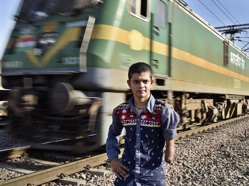 Ankit Rai poses near the spot where he lost his arm. In 2007, six-and-a-half-year old Ankit was kidnapped from a playground near his home. After a frantic search was launched for the missing boy, his kidnappers dumped him in the middle of two railway tracks, thinking he was dead. A speeding train ran over his arm. But Ankit survived. After gaining consciousness, Ankit lifted his amputated arm and somehow found his way home. The kidnappers who had demanded a ransom of Rs 7 lakh were caught later and turned out to be tenants in the family's house. Ankit's courage earned him the National Bravery Award in January 2008.  (Sanjeev Verma/HT Photo)