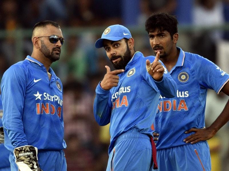 Indian skipper MS Dhoni with Virat Kohli and Jasprit Bumrah against New Zealand during the second ODI at Feroz Shah Kotla ground in New Delhi on October 20, 2016.  (Mohd Zakir/HT PHOTO)