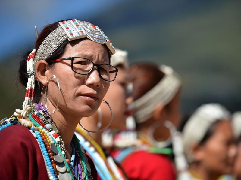 Fairs and festivals have always been an integral part of the indigenous communities of the state. A local woman wearing traditional dress poses during the opening ceremony.  (AFP)