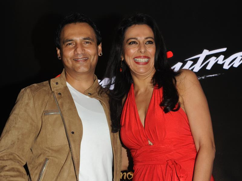 Marc Robinson  and Pooja Bedi pose during a promotional event. (AFP Photo)