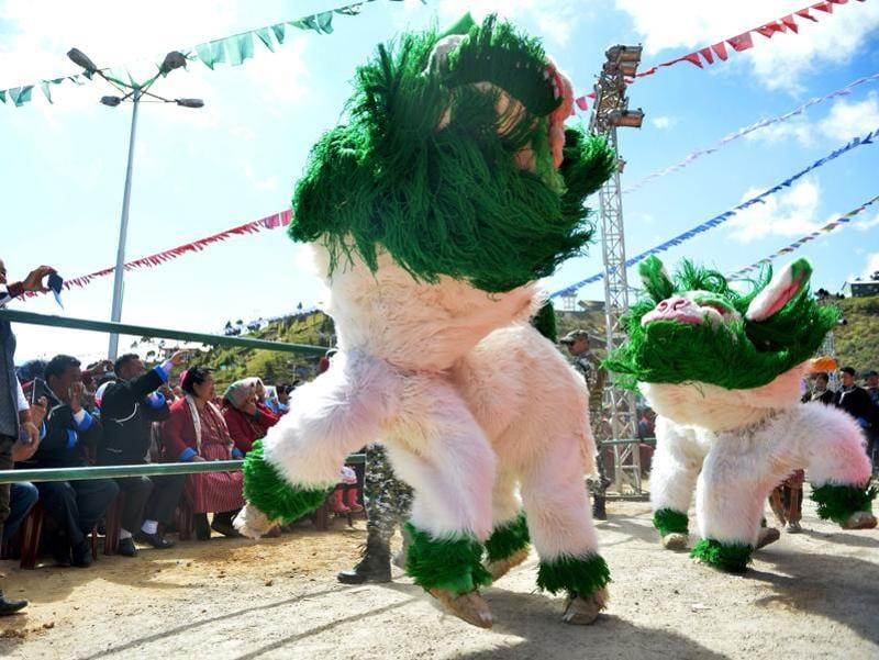 The inhabitants of Tawang are called Monpas. Men do the snow lion dance during the festival. (AFP)