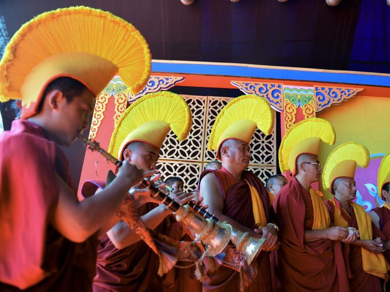 The local legend says that once in the 17th century, a Tibetan monk Mera Lama saw a beautiful horse wandering in the valley. Struck by its beauty, he tried to capture it but the horse disappeared. Buddhist monks performing at the festival.  (AFP)
