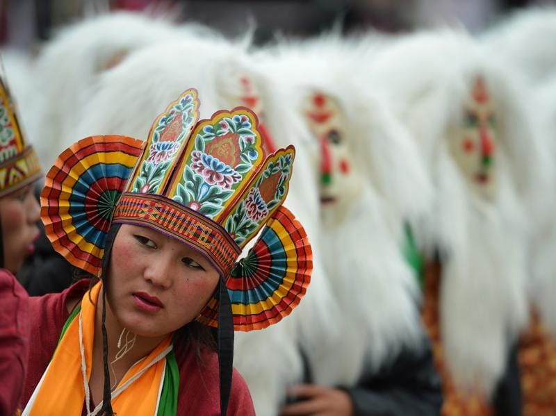 A tribal girl looks on during the second day of the three-day Tawang festival in Tawang, near the Sino-India border in Arunachal Pradesh on October 22, 2016. The Tawang Festival 2016 runs from October 21 with a three-day programme to promote tourism and showcase the culture and traditions of the district in particular, and the state in general. (AFP)