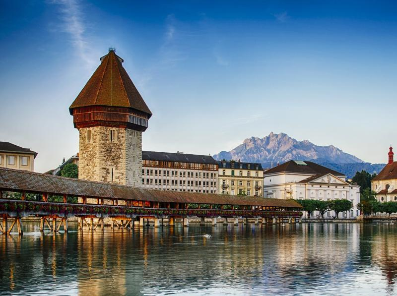 A popular destination with tourists, Lucerne in central Switzerland is located next to Lake Lucerne and in close proximity to mounts Pilatus and Rigi in the Swiss Alps. (Rkristoffersen/iStock)