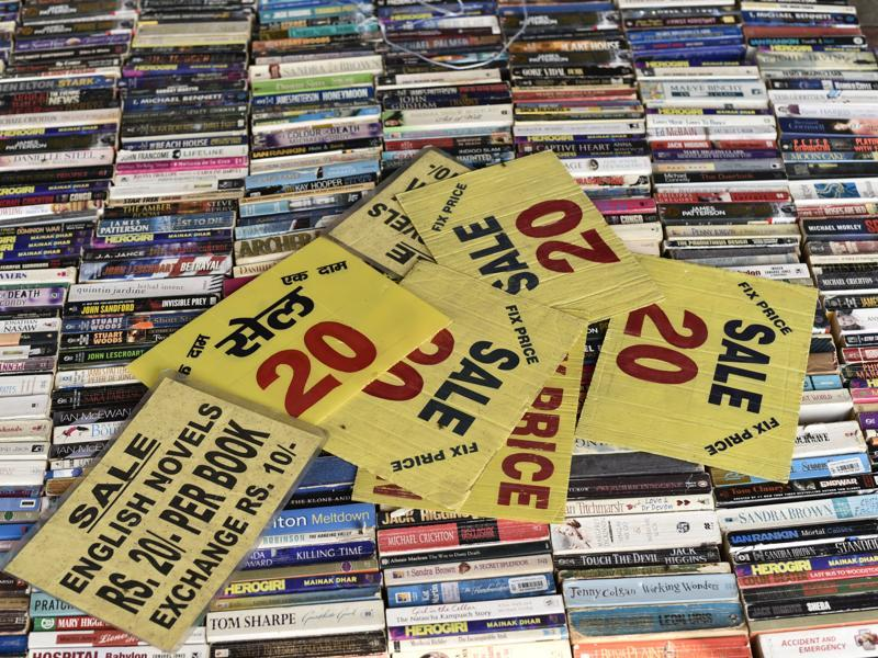 Avid readers often avail exchange schemes at the book bazaar, where they can get new books in exchange of older ones. This makes the bazaar Delhi's own open-air lending or rotating library.  (Vipin Kumar/HT PHOTO)