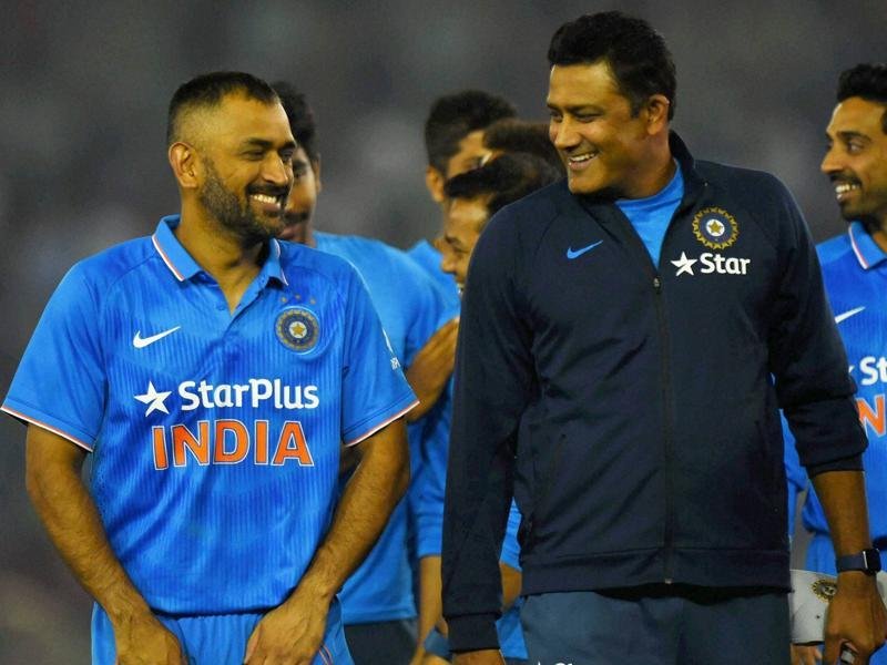 India captain Dhoni and coach Anil Kumble share a lighter moment during the post-match presentation ceremony. (PTI)